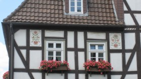 Half-timbered house with wall painting in Ziegenhain.
