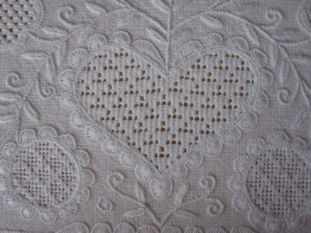 Heart outlined, except for the bottom and top center, with uniform and evenly distributed half-eyelet scallops. The thread weight is correct, and the stitches have been worked with the appropriate density.