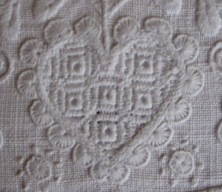 Heart outlined with half-eyelet scallops. The thread weight is correct with appropriately dense stitches. Some of the scallops should be closer together and the bottom point should have only one scallop.