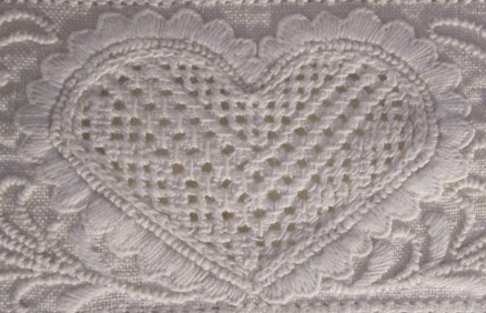 Heart outlined with scallops. The thread weight is correct and the density of the stitches is good. However, the treatment of the scallops at the heart's lower point is not attractive.