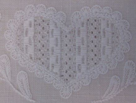 Heart outlined, except for the bottom and top center, with uniform and evenly distributed half-eyelet scallops. The thread weight is correct, but the density is not. The scallops should have more stitches.