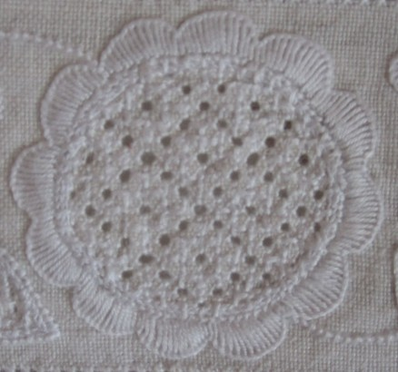 Circle outlined with fairly uniform and evenly distributed scallops. The thread weight is correct, but the Blanket stitches could be more dense.