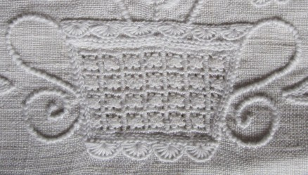 basket decorated at both the top and bottom edges with uniform half-eyelet scallops