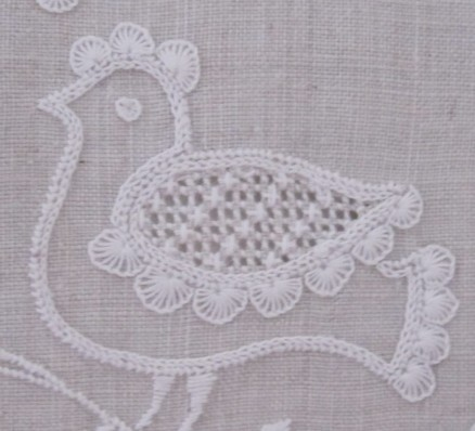 bird decorated with uniform half-eyelet scallops