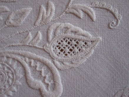 bud decorated with Satin stitch scallops arranged fan-like and in graduated sizes