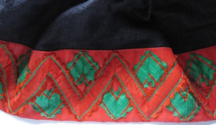 "Skirt of the red costume, trimmed with red ""Damest"" 8 cm deep and additionally decorated with two silk ribbons creating a double zig-zag line."