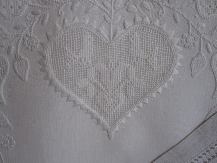 Heart outlined, except for the bottom point and the top concave center, with uniform and evenly distributed points. The thread weight is correct, and the stitches have been worked with the appropriate density.