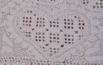 Heart outlined with uneven Blanket stitch points. The thread weight is correct and the density of the stitches is good. However, the treatment of the points at the heart's lower point is not attractive.
