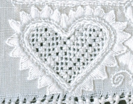 Heart outlined with uneven Blanket stitch points. The thread weight is correct and the density of the stitches is good. However, the treatment of the points at the heart's lower point is not attractive. In this example, one can see that the embroiderer had difficulty distributing the points evenly.