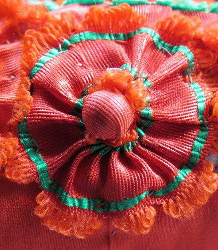 tritzer made with one silk ribbon and additionally decorated with one berry sewn in the center