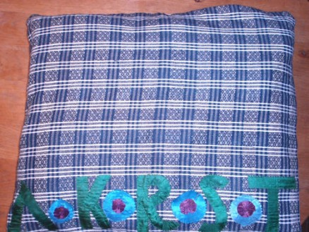 parade cushion made of typical Schwalm blue and white woven linen with tritzer embellishment and initials