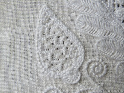 Rows of Rose stitches and stair-step Satin stitches.