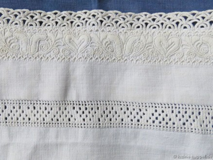 Sleeve cuff of a traditional Schwalm bodice decorated with needlelace, whitework, and a needleweaving hem.